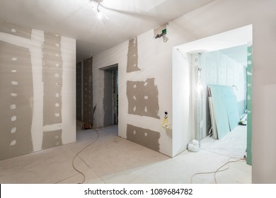 Metal frames and plasterboard -drywall- for gypsum walls and electric wires  in apartment is under construction, remodeling, renovation, overhaul, upgrading extension, restoration and reconstruction.