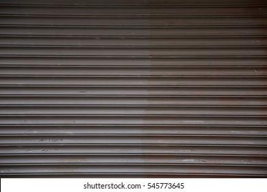 metal garage door pulled down covering entrance
