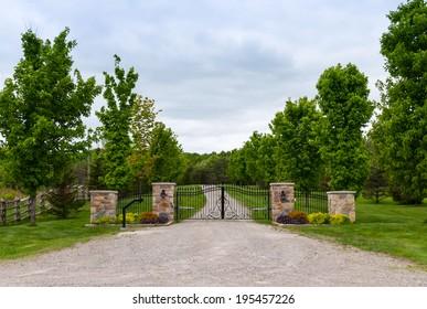 Metal gate with four stone pillars