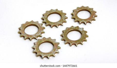 metal gear wheels on white ground