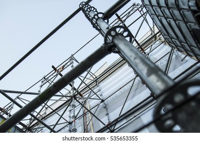 Metal girder extensive scaffolding providing platforms for stage structure support