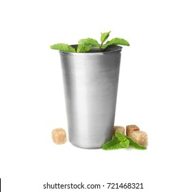 Metal glass with mint julep on white background