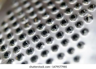 Metal grater pattern close up. Selective focus