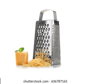 Metal grater and piece of cheese on white background