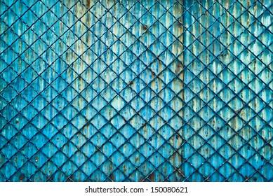 Metal grid fence as old grunge background