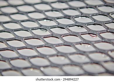Metal grid with regular pattern