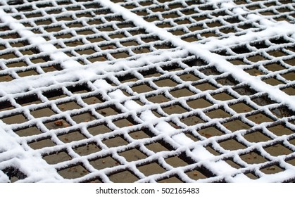 metal grill in the snow