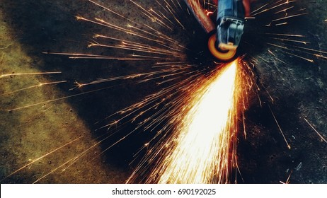 Metal grinding on steel with flash of sparks close up
