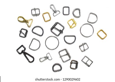 Metal half rings, buckles and carbines on a white background