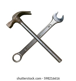 Metal Hammer and Spanner. Isolated cross made of spanner key and hammer.