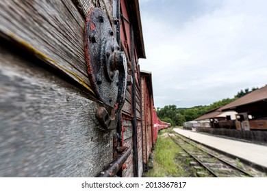 Metal handle on the old wooden door at the historical freight train at Lamanstre town. France 2020