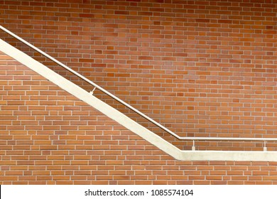 Metal handrail at brick wall