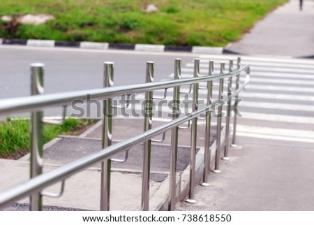 Metal handrails on crossing the road