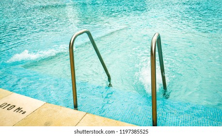 metal handrails in the pool