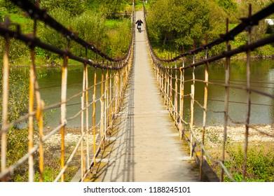 metal hanging bridge over the river