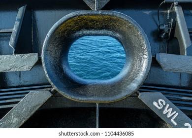 Metal hawse of a cargo ship.