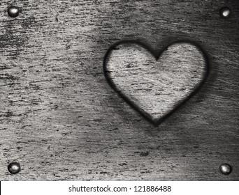 Metal heart on metal plate