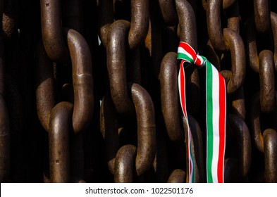 Metal heavy chains with a Hungarian flag ribbon on, Budapest, Hungary.