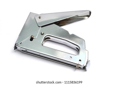 Metal heavy duty staple gun isolated on a white background