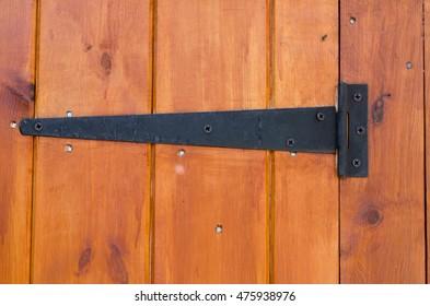Metal hinge on a wooden door