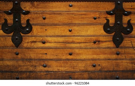 Metal hinges on wooden background.
