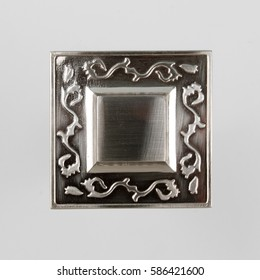 Metal hold-back for curtain on the gray background. Metal tiebacks for curtain with fasteners on the gray background.