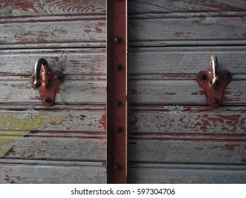 Metal hooks on wood