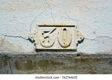 metal house number thirty (30)