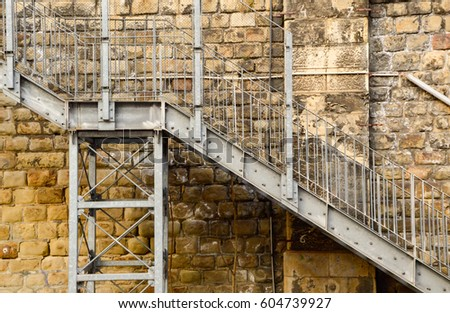 Metal Industrial Stairs At The Stone Wall