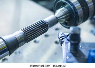 Metal industry, cutter lathe during the processing of the metal shaft.