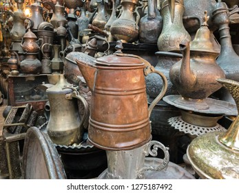Metal kettles for sale in a shop amid the Old City markets of Jersualem in Israel create an interesting background.