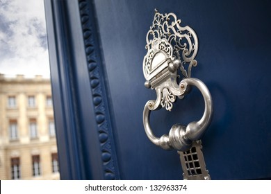 Metal knocker on the door of a palace in Bordeaux, France