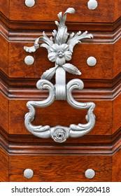 metal knocker on the wooden door