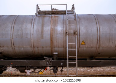 Metal ladders and platform at the top of a railway oil tank wagon at the station