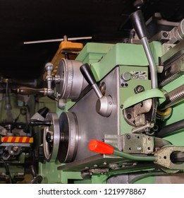 Metal lathe at work in a wotkshop. Bottom view.
