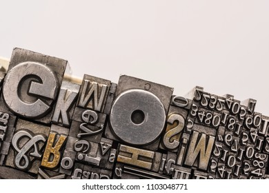 Metal Letterpress Types.  A background from many historical typography letters in black and white with white background.