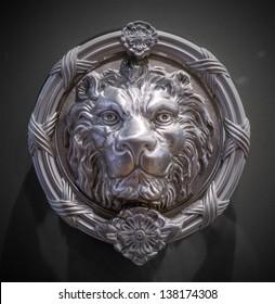 Metal lion head on the door