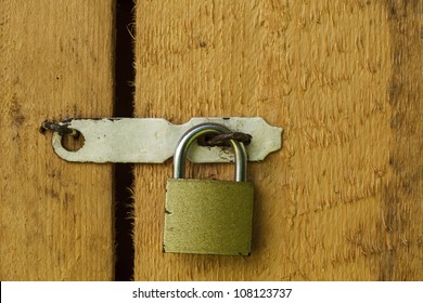 Metal lock on the wooden door closeup
