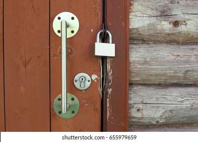 Metal lock on a wooden door