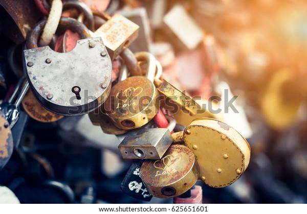 Metal locks. A bunch of locks. Heart locks