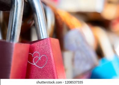 Metal Love locks or padlocks in a row. Close up