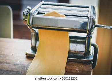 Metal machine for making pasta and fresh dough for lasagna. Making fresh homemade pasta or pastry at home.
