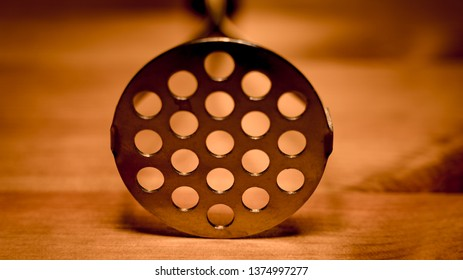 Metal masher on the wood table