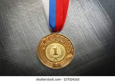 Metal medal with tricolor ribbon on steel scratchy background