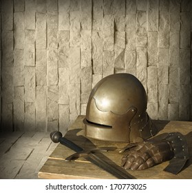 Metal medieval armor and blank stone wall in the background