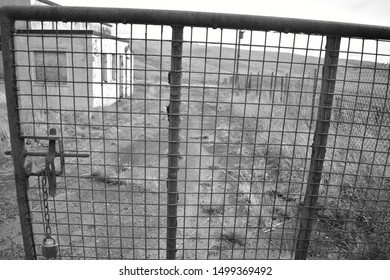 The metal mesh gate into a derelict property which sits in remote moorland,near Moffat, Scotland
