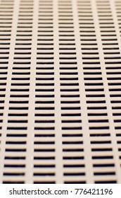 Metal mesh texture with rectangular holes.