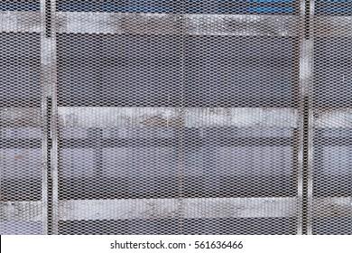 Metal mesh. Wall of metal mesh. Metal structure of the bars and mesh. Metal grid.