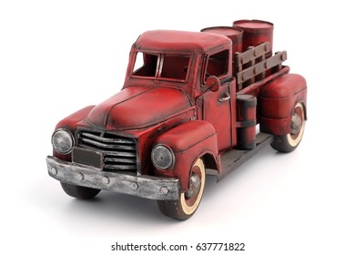 Metal model of an old truck with barrels for fuel (manufactured in 1934)