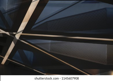 Metal in modern architecture. Collage photo of office building framework and decorative perforated wall panels in twilight. Grid structures seen through each other. Architectural surfaces.